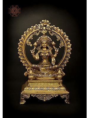 Four Armed Goddess Lakshmi Seated On Throne