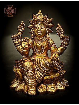 Four Armed Goddess Lakshmi Seated on Lotus