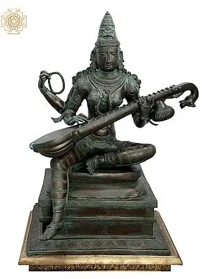 Seated Saraswati, In All Her Beauty And Solemnity