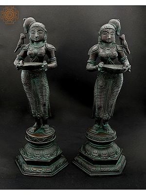 Twin Deepalakshmis With Parrots Perched Upon The Shoulder