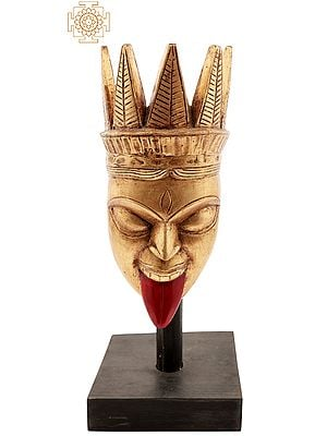 Goddess Kali Mask on Wooden Pole