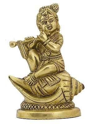 Baby Krishna Seated on Conch Playing the Flute