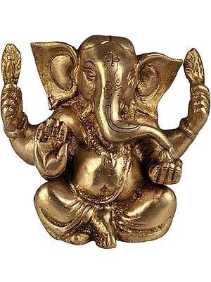 Baby Ganesha Enjoying Modak