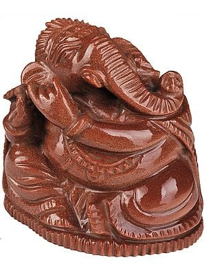 Lord Ganesha Playing Flute (Carved in Sunstone)