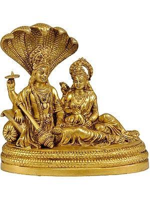Bhagavan Vishnu and Devi Lakshmi  Seated on Sheshnag