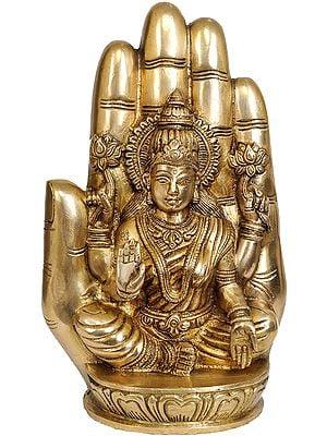 Goddess Lakshmi Seated on Lotus against the Aureole of a Hand