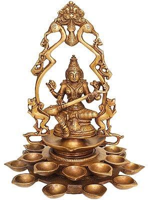 Goddess Saraswati with Multiple Diyas