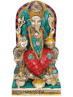 Four Armed Ganesha Seated on Throne
