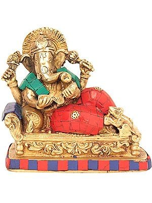 Relaxing Lord Ganesha Reading the Ramayana