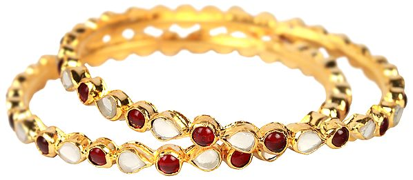 A Pair of Kundan Bracelets with Garnet-Red Beads