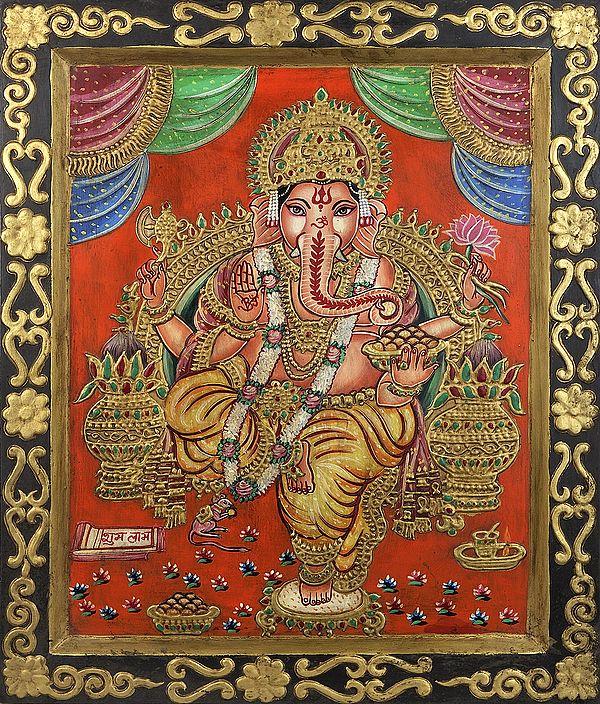 Lord Ganesha with a Bowl of Modaks (Laddoos)