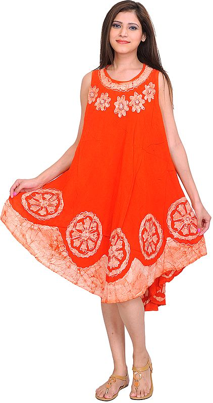 Fiesta-Orange Dress with Batik Printed Flowers and Threadwork