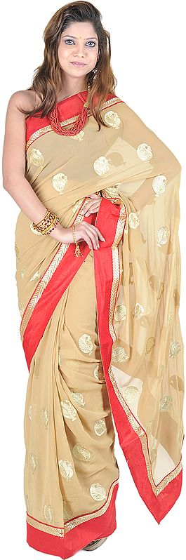 Curry-Mustard Sari with All-Over Embroidered Leaves and Red Patch Border