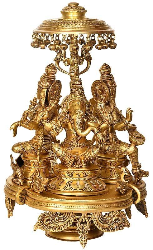 Lakshmi,Ganesha and Saraswati Seated on Moving Chowki with Parasol