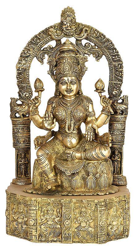 Goddess Lakshmi Seated on Lotus Base Carved with Hindu Deities