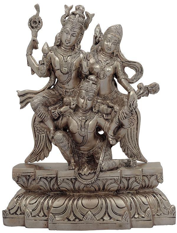 Garuda Flying with Bhagawan Vishnu and Devi Lakshmi