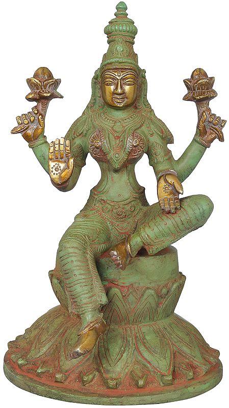 Chaturbhujadharini Devi Lakshmi, Seated On A Giant Lotus