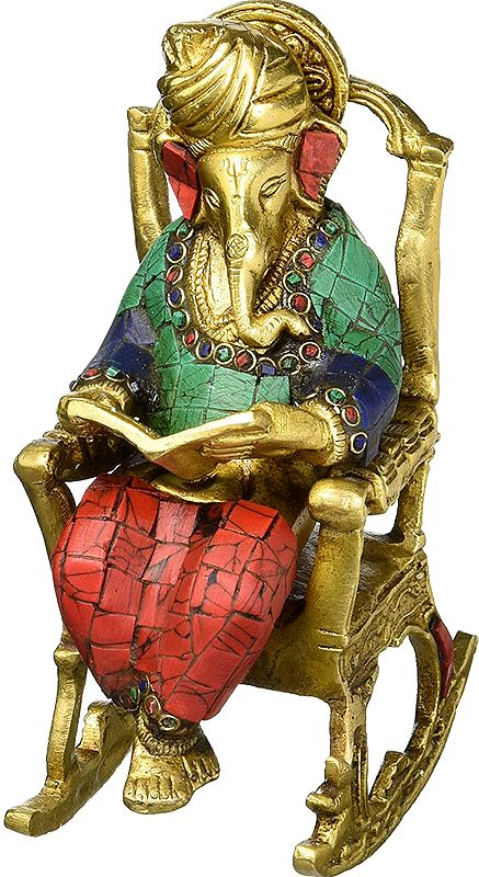 Lord Ganesha Reading Book on Rocking Chair
