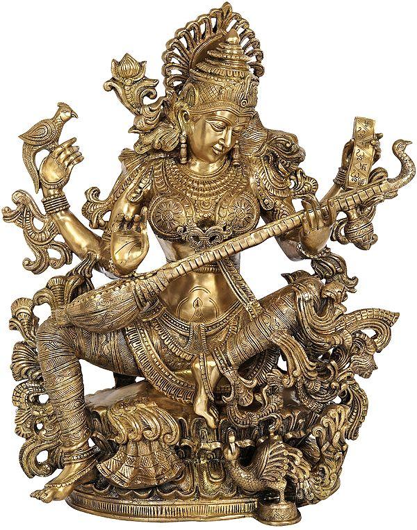 Devi Sarasvati, Cradling The Veena Like A Mother Her Baby