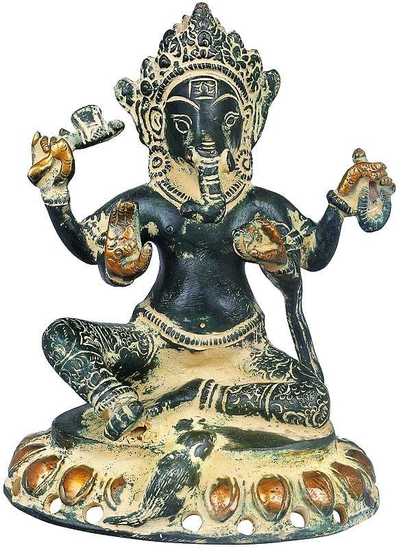 Chaturbhuja Lord Ganesha Seated on Lotus