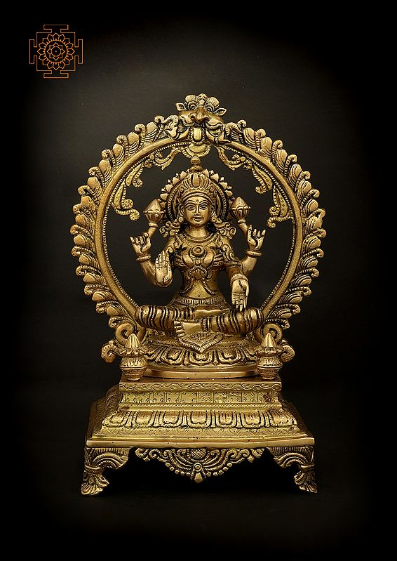 Chaturbhujadharini Devi Lakshmi Seated On A High Plinth