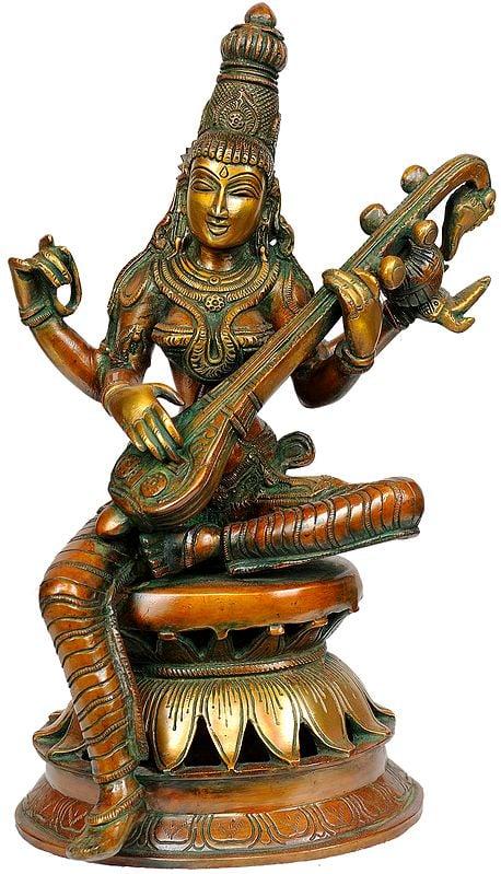 Goddess Saraswati Seated in Lalitasana on Lotus Throne