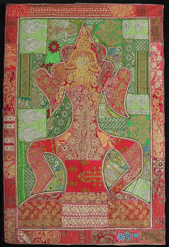Coral-Paradise Hand-Crafted Meditating Buddha Wall Hanging from Gujarat with Upcycled Embroidery Patchwork